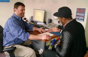 Supported Employment Job Coach Rick Alvord, left, offers help with resumes and job applications.